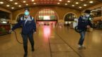 Workers disinfect the Hankou Railway Station in Wuhan, a day before the shutdown
