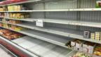 Empty shelves are seen where French products were displayed at Kuwaiti supermarkets