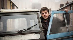 Tom Burke plays Cormoran Strike