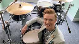 Owain drums up his own House Band as hundreds join him and play along