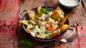 Fried eggs and green salsa on tortilla chips (chilaquiles)