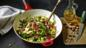 Greens with bacon and hazelnuts