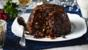 Traditional Christmas pudding with brandy butter