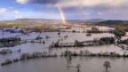 Rainbow over floodwater