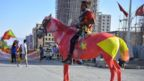 "A resident of Mekelle region rides a horse painted in the colours of the Tigray regional flag as they attend celebrations marking the 45th anniversary of the launching of the ""Armed Struggle of the Peoples of Tigray"", on February 19, 2020, in Mekelle. - The political party that dominated Ethiopian politics for nearly three decades staged massive anniversary celebrations on February 19 that highlighted rising tensions with the prime minister""s government and neighbouring Eritrea. The Tigray People""s Liberation Front (TPLF) led the overthrow of the Marxist ruler Mengistu Haile Mariam in the early 1990s and controlled the ruling coalition that took over"