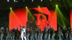 Band performing on stage with a large image of Thomas Sankara in the background