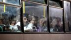 Migrants on a bus