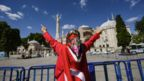 """A woman wrapped in a Turkish national flag gestures outside the Hagia Sophia museum on July 10, 2020 in Istanbul as people gather to celebrate after a top Turkish court revoked the sixth-century Hagia Sophia""""s status as a museum, clearing the way for it to be turned back into a mosque"""