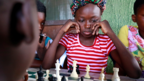 Children play chess in Makoko, Lagos, Nigeria - Wednesday 5 May 2021