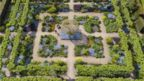 An aerial photo of a garden filled with flowers and trees in an angular design