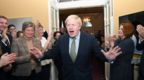 Boris Johnson is greeted by staff