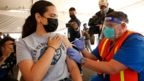 A woman receives a coronavirus vaccine in Los Angeles