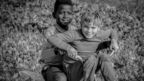 An image from a working-class area of Atlanta where white and black children played together, 1970