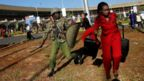 Kenya Airways workers are dispersed by riot police officers