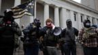 Militia groups gather to protect protesters as supporters of President Donald Trump protest against the election of President-elect Joe Biden, outside the Ohio State Capitol in Columbus