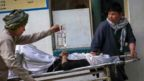 People carry an injured girl into a hospital after an explosion in downtown Kabul, Afghanistan, 08 May 2021.