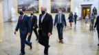 Mark Meadows and Steven Mnuchin walking into Congress