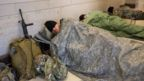 Members of the National Guard rest in the Capitol Visitor Center on Capitol Hill in Washington,