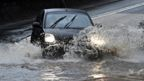 A car drives through flood water in Strines, on 20 January 2021