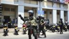 Security personnel stand guard after a controlled explosion in front of a movie theatre in Colombo