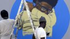 Members of the Senegalese graffitti collective RBS Crew painting a wall at Cheikh Anta Diop University in Dakar, Senegal - Saturday 21 March 2020