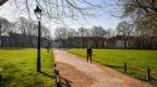 A lone person walks through Queens Square, Bristol