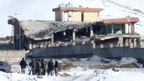 A collapsed building at a military base following a car bomb attack in Wardak province, 21 January 2019