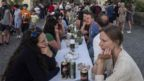 "People picnic to celebrate a ""symbolic farewell"" to coronavirus"