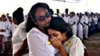 Two women mourn during a funeral service at St Sebastian's Church in Negombo on April 23, 2019