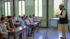 Boys attend their class at Istiklal school in Kabul on September 18, 2021