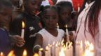 Children light candles during an event to pray and remember those who have lost their lives due to HIV/Aids, during World AIDS Day in Kariobangi, Nairobi, Kenya, 01 December 2019