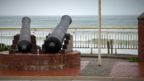 two cannons beside the ocean