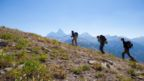 A team of alpine archaeologists hikes towards base camp in the Teton Range, Wyoming