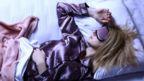 Woman sleeping wearing sleeping mask