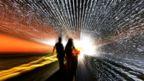 Warped image of two people walking