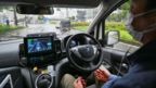 A person sitting in a self-driving vehicle (Credit: Kazuhiro Nogi/AFP/Getty Images)