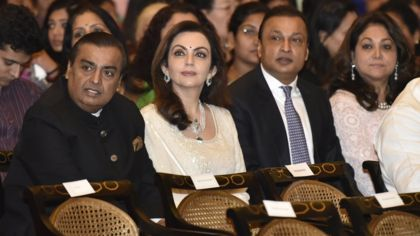 India's richest man helps brother avoid jail